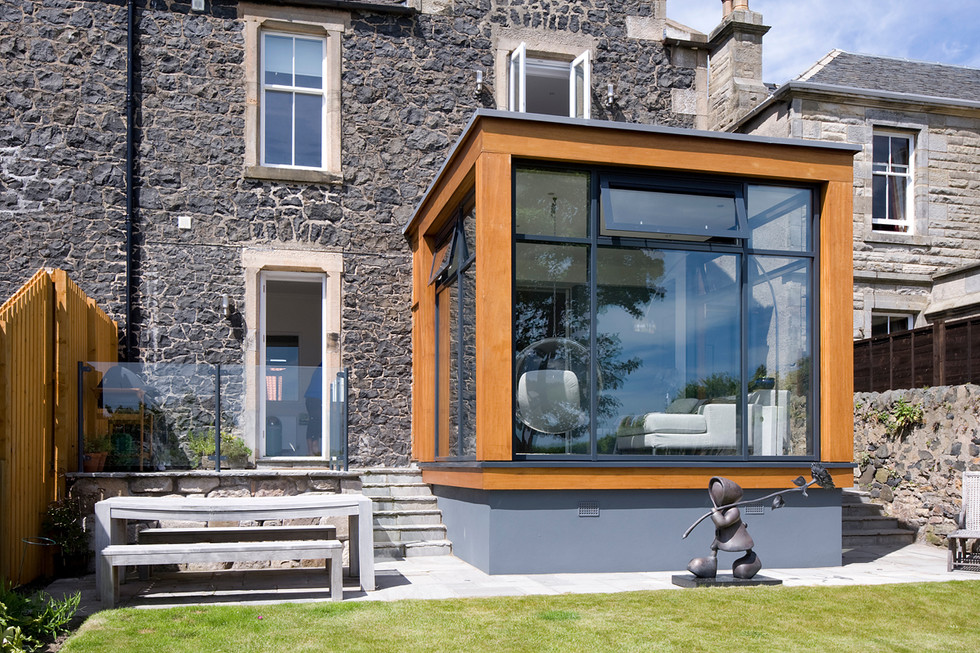 Coastal-holiday-home-glass-extension-exterior-architectural-photography