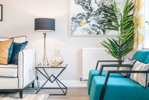 Barratt-Homes-lifestyle-lamp-side-table-indigo-armchairs-showhome-photography