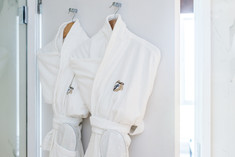 hotel-dressing-gowns-hung-door-commercial-photography