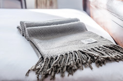 scarf folded on bed holiday let photography