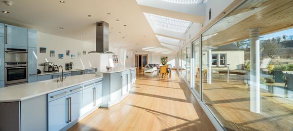 glass-wall-to-garden-long-kitchen-lounge-interior-photographer