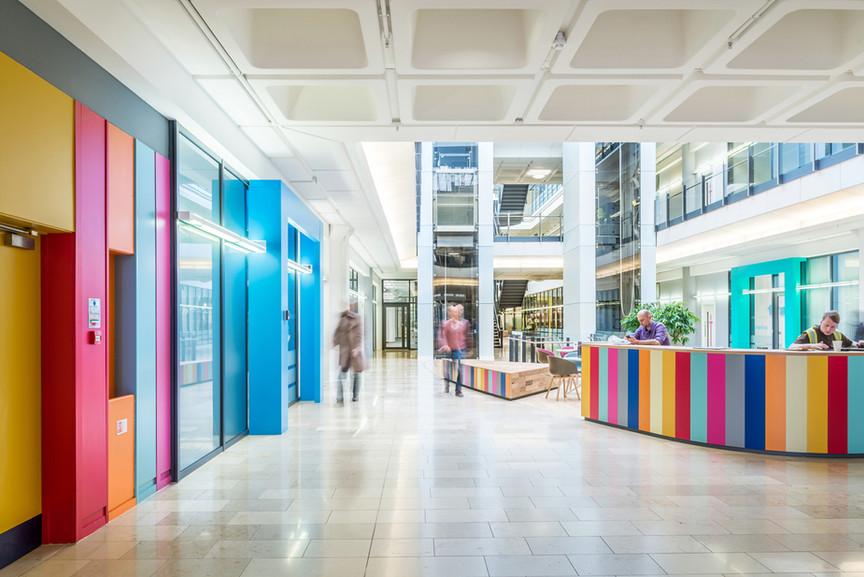 architectural-photography-scotland-bright-office-atrium-colourful-designer-furniture