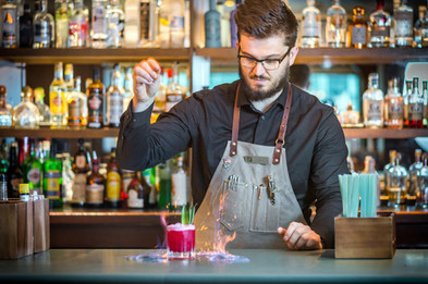 barman making a cocktail with fire, commercial photography