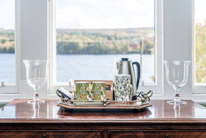 tea tray with mugs infront of window view interior photography