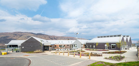 timber clad modern school mountains backdrop exterior school photography