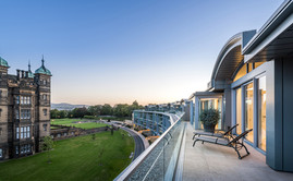 Cala-Homes-penthouse-terrace-sunloungers-dusk-showhome-photographer