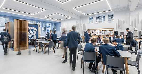 modern bright school canteen with pupils moving interior architectural photography