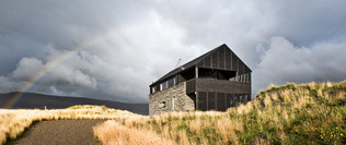 holiday let photography: timber and stone house rainbow over