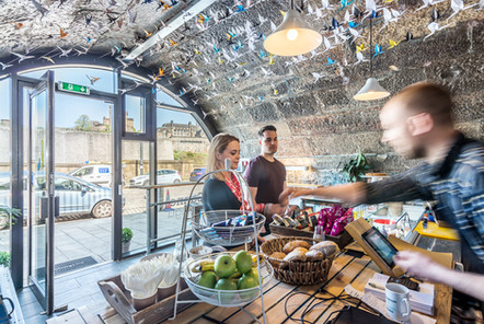 Market-Street-arches-Edinburgh-cafe-serving-customer-vaulted-arch-interiors-photographer