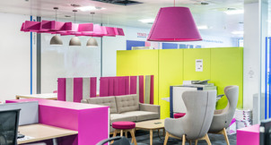 office photography of break out meeting space with bright coloured lights and screens