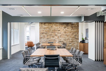 interior office photography of meeting room with sub-dividing partition and exposed brickwork
