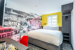Bright hotel bedroom with cityscape wallpater interior photography