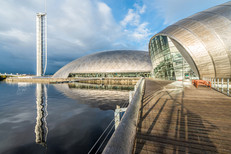 exterior architectural photography or stainless steel clad sculptural buildings by the river Clyde
