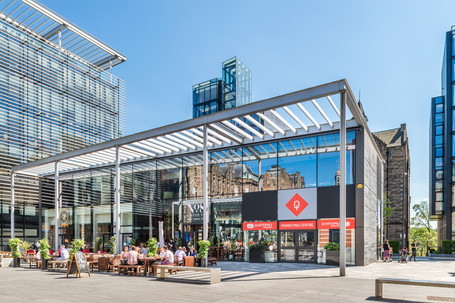 exterior architectural photography of steel frame glass cafe with people outside
