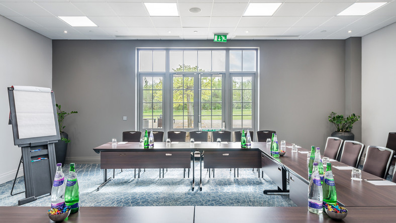 interior hotel photography of meeting room set up with drinks and white board