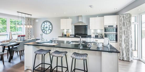David-Wilson-Homes-bright-granite-kitchen-island-bar-stools-showhome-photography