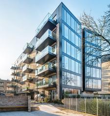 glass-balconies-brick-modern-apartment-block-architectural-photographer