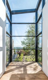 glazed-box-museum-view-outside-blue-sky-trees-photographers-Edinburgh
