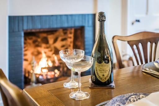 champagne by roaring fire holiday let photography