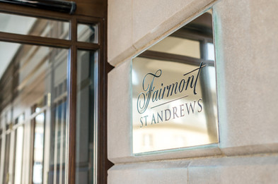 detail photography of brass entrance plaque to Fairmont Hotel