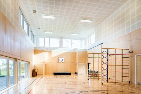 modern bright school games hall interior architectural photography