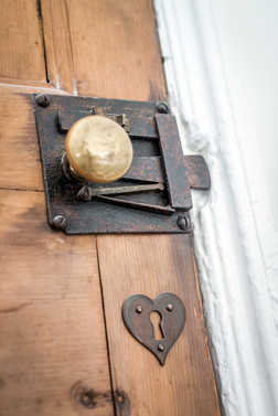 holiday let photography - refurbished timber door love heart lock