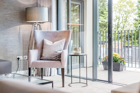 Cala-Homes-lifestyle-chair-next-to-open-patio-doors-terrace-showhome-photographer