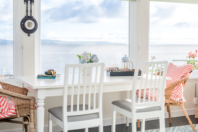 interior-photography-holiday-let-white-dining-table-sea-view
