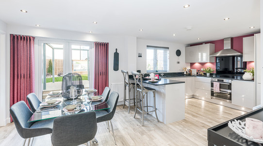 Barratt-Homes-kitchen-family-red-curtains-white-gloss-showhome-photography
