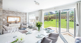 Cala-Homes-kitchen-family-open-bifold-doors-sunny-garden-showhome-photography