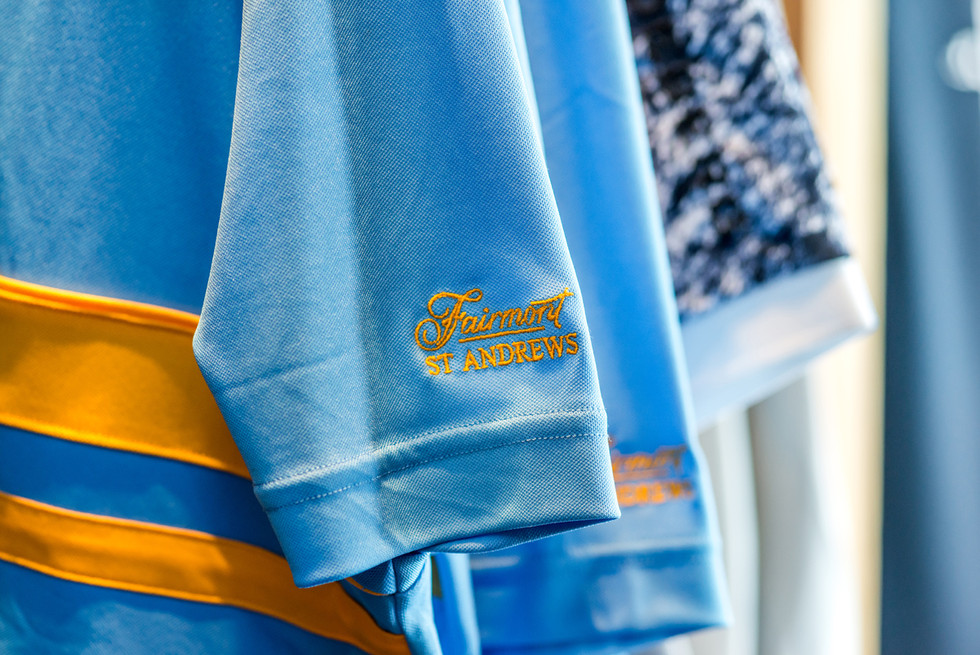 golf-club-blue-gold-polo-shirt-branding-commercial-photography