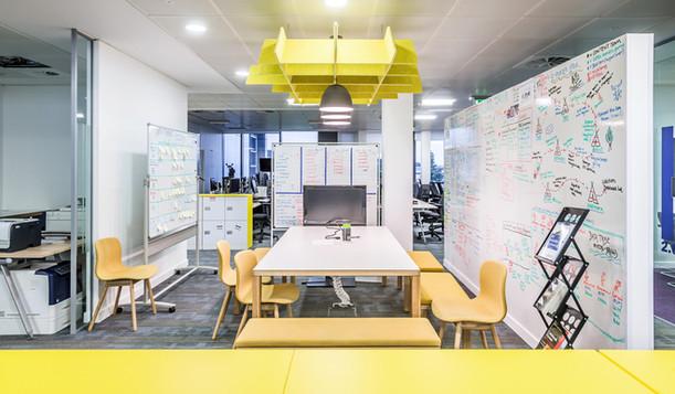 interiors-photographer-Edinburgh-breakout-office-bright-colourful-white-board-wall