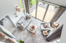 Cala-Homes-looking-down-garden-room-coffee-table-armchairs-showhome-photographer