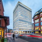 dusk architectural photography of refurbished office block with traffic streaks