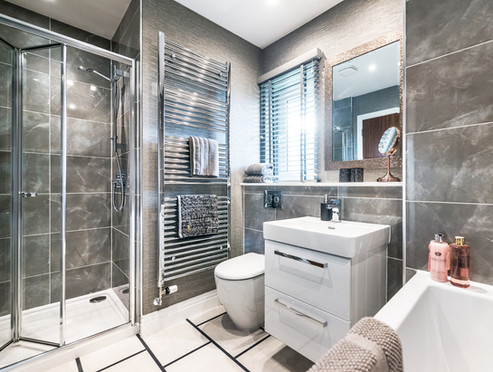 Cala-Homes-ensuite-grey-marble-tiles-chrome-towel-rail-showhome-photography