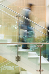 interior architectural photography of people in motion walking down office stair