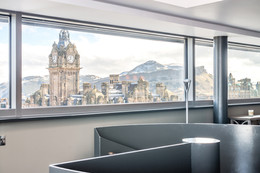 stunning cityscape view through holiday let window
