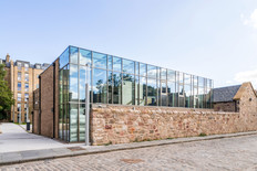 exterior architectural photography: glazed curtain wall student residence block