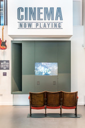 cinema art exhibit with chairs at Carnegie Library and Art Gallery