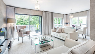 Cala-Homes-bright-stylish-living-room-glass-coffee-table-cream-sofas-showhome-photography