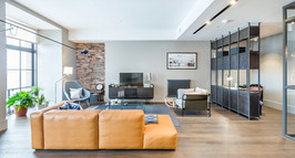 cool-modern-living-room-with-exposed-brickwork-holiday-let-photography