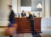 Commercial photography showing reception desk of Balmoral Hotel in Edinburgh with person checking in