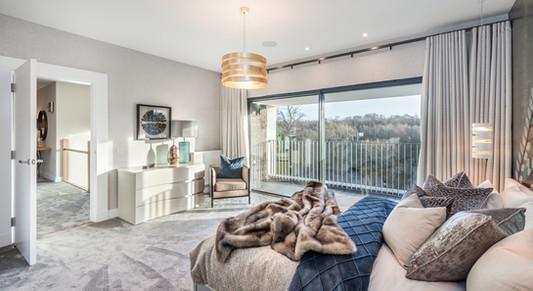 interiors-photographer-scotland-luxury-master-bedroom-faux-fur-throw-dressing-table-balcony-view-sunlight-stunning