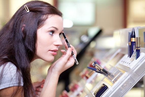 Young woman testing cosmetics.jpg