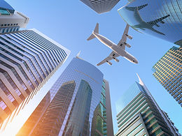 airplane-flying-over-skyscrapers-n-city-