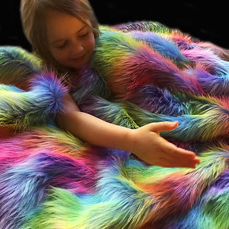 Girl with Rainbow Wave Faux Fur Weighted