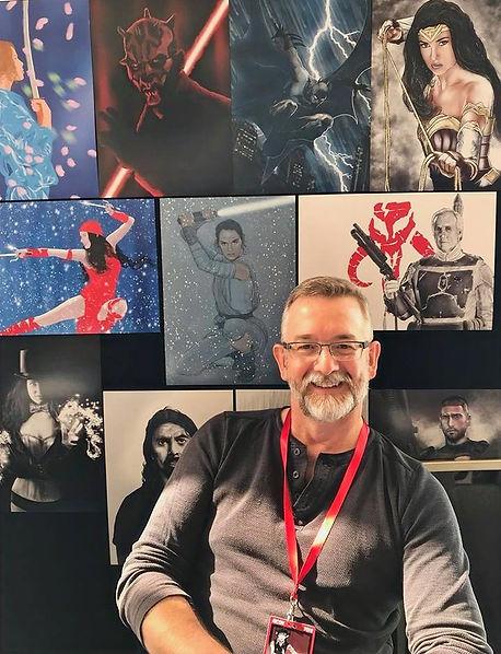 Tasmanian artist Tony Menzie amongst his