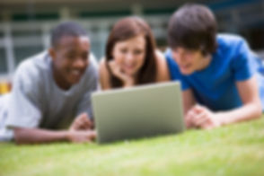 college-students-using-laptop-on-campus-