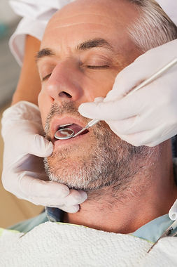 dentist-examining-a-patients-teeth-in-th