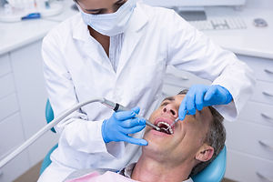 dentist-examining-patient-at-clinic-8H3W